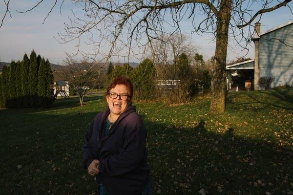 Pauline stands in her neighborhood.