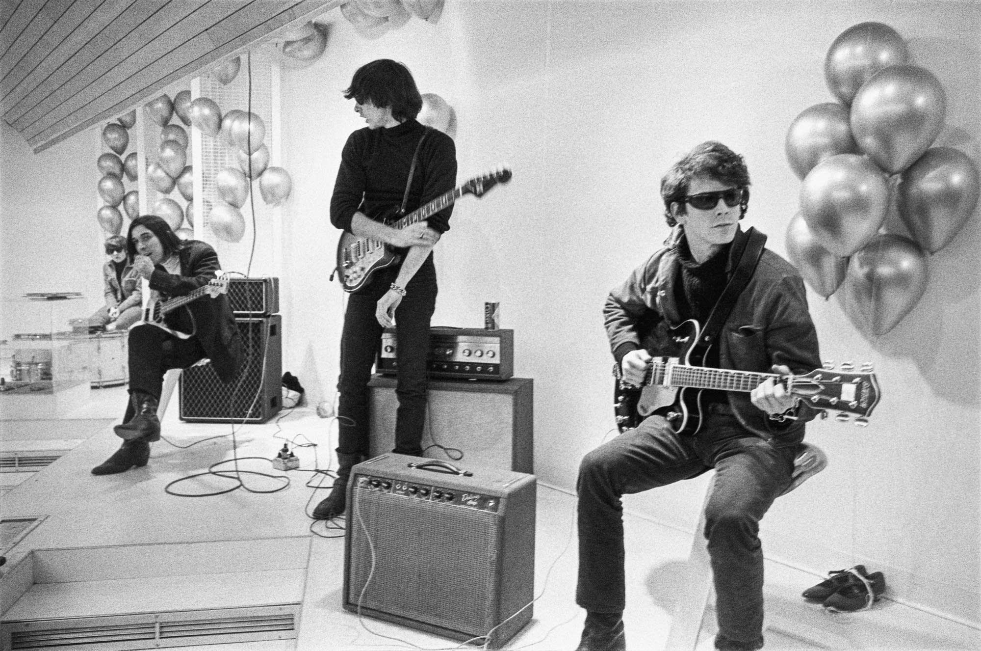 Black and white image of the Velvet Underground in an art gallery.