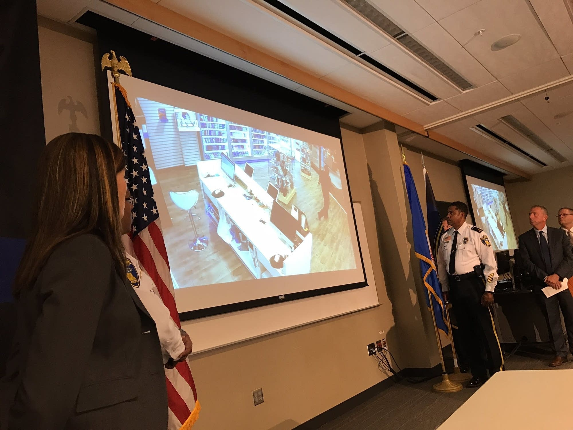 St. Cloud police chief Blair Anderson plays video