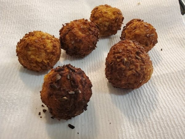 6 deep fried ball-shaped appetizers that look like hushpuppies