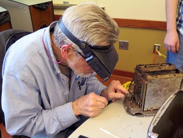 Volunteer David Gamble repairs a toaster.