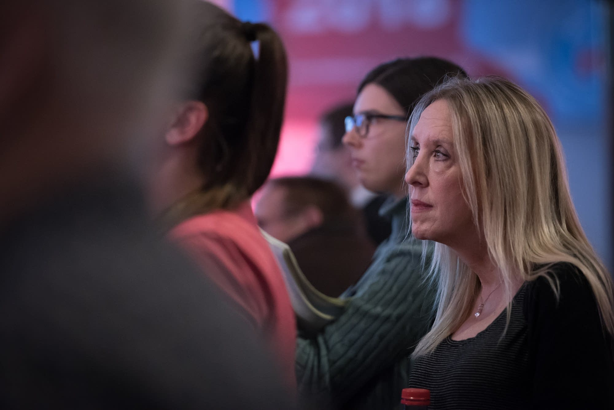 A woman listens to Jeff Johnson's concession speech.