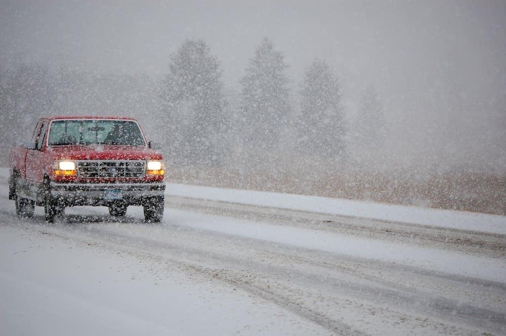 Truck tries to navigate snowy highway