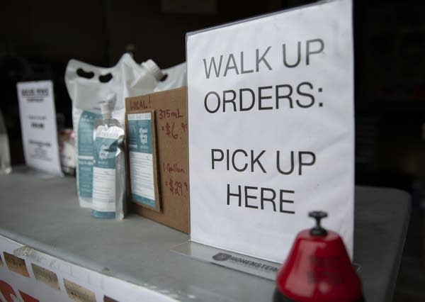"A sign reading ""Walk up orders: pick up here"" sits beside a bell."