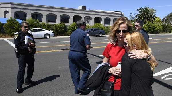 Jessica Parks (right) hugs Tina White outside the Chabad of Poway Synagogue
