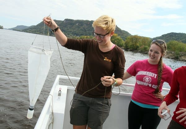 Biology students collect water samples.