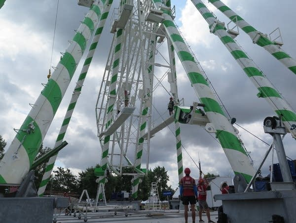 Workers assemble the Great Big Wheel