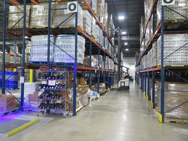 A scene of a large warehouse with boxes.
