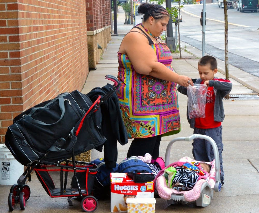 Courtney Peterson and her children on the street i