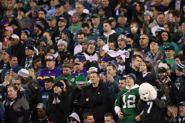 Eagles fans watch their team in the NFC Championship game.