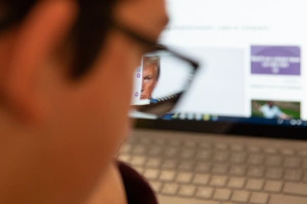 President Trump is seen through an eyeglass.
