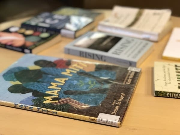 A book sits on a desk