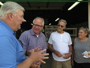 U.S. Rep. Tim Walz listens to state Sen. Greg Clausen.