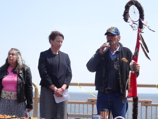 Fond du Lac tribal elder Skip Sandman presents an Eagle Staff