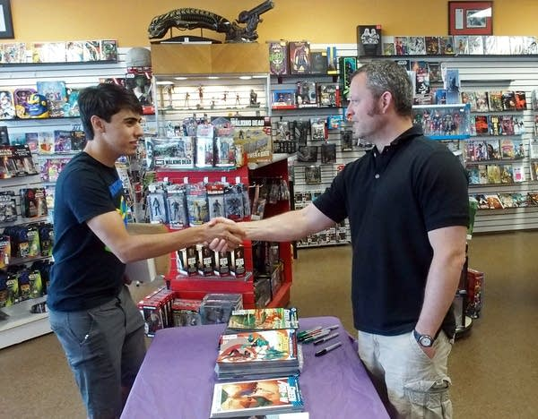 Ben Percy greets a fan at a signing at Hot Comics in New Hope.