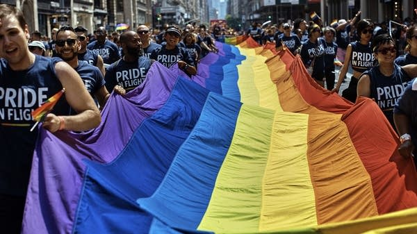 Revelers carry a rainbow flag during the New York City Pride Parade
