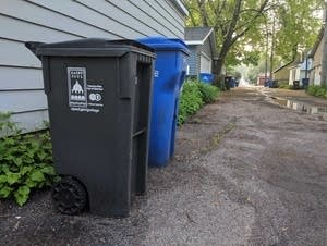 Trash carts line an alley in St. Paul.