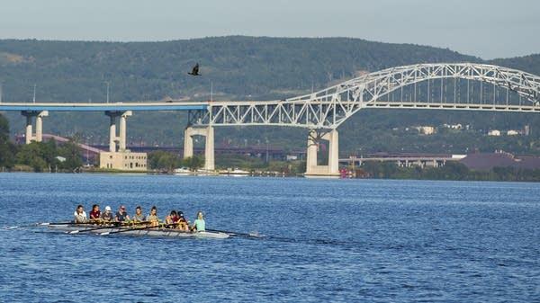 Rowers move past Blatnik Bridge.