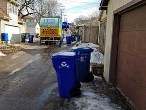 A Eureka recycling truck picked up bins in an alley off of Randolph Ave.