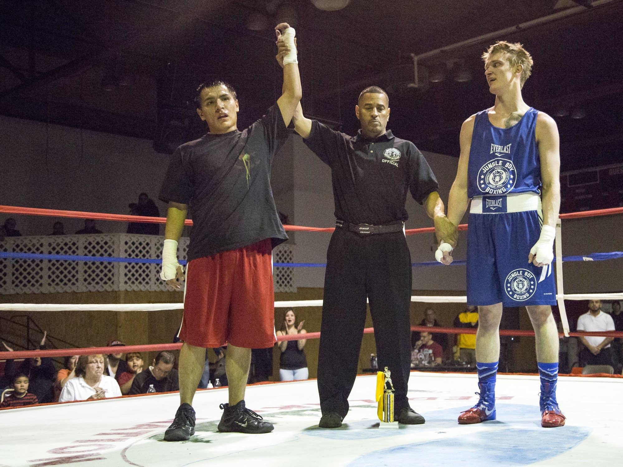 Zack Morrison is declared winner over Danny Huffman, Jungle Boys, Duluth.
