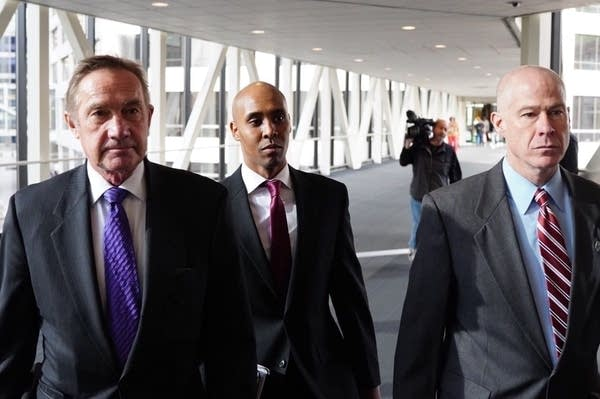Mohamed Noor with his attorneys Peter Wold and Thomas Plunkett.