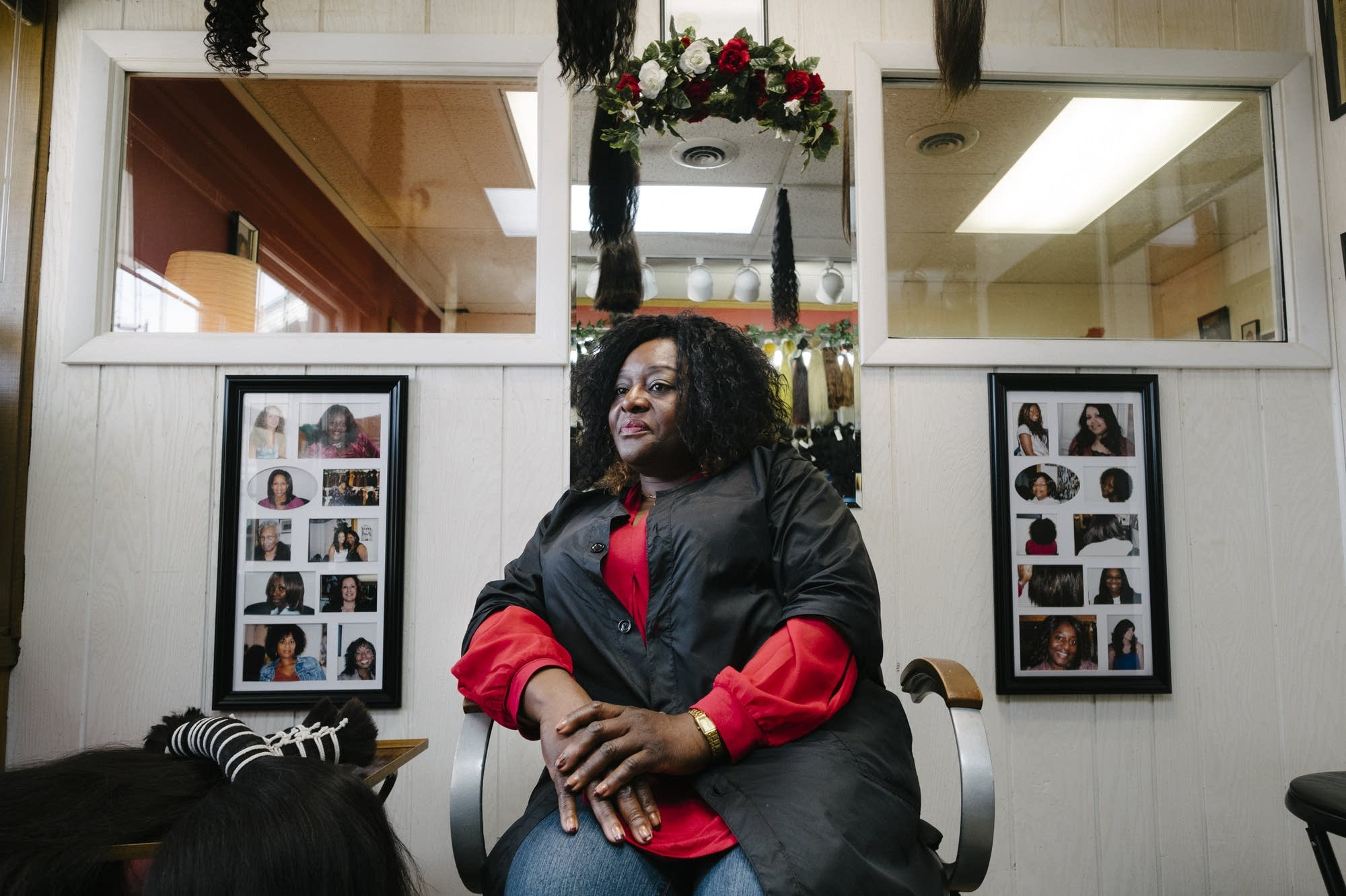 Pampered Hair Haven owner Joyce Iyawe sits for a portrait.