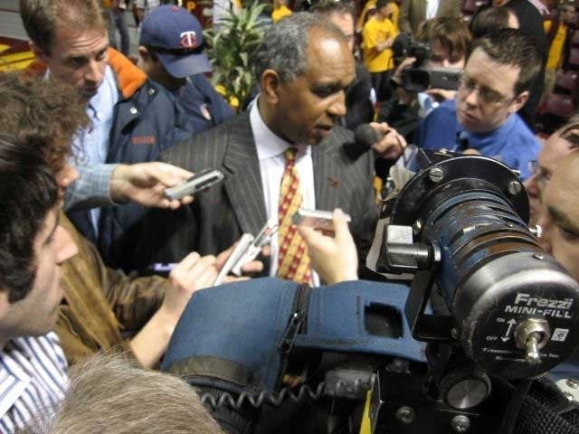 Surrounded by reporters