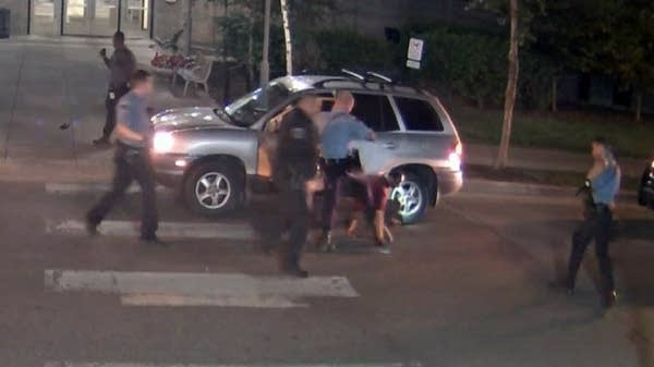 Video frame grab of alleged assault by officer