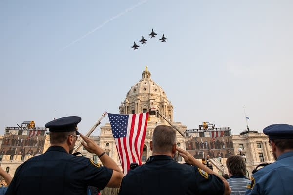 Planes fly over a capitol building.