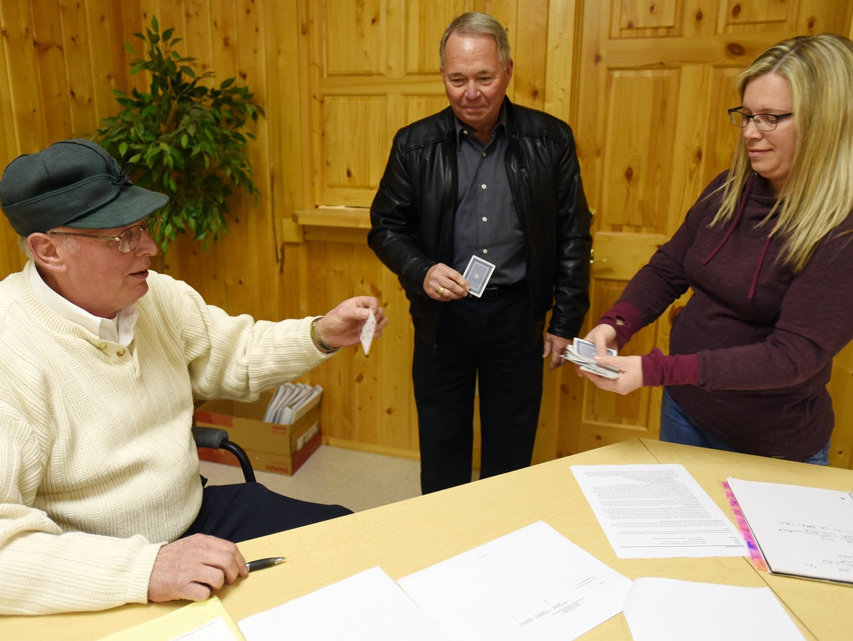 Kevin Larson held his card as mayor Paul Allen considered his draw.