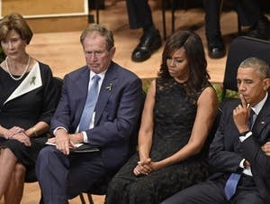 Laura and George Bush, Michelle and Pres. Obama