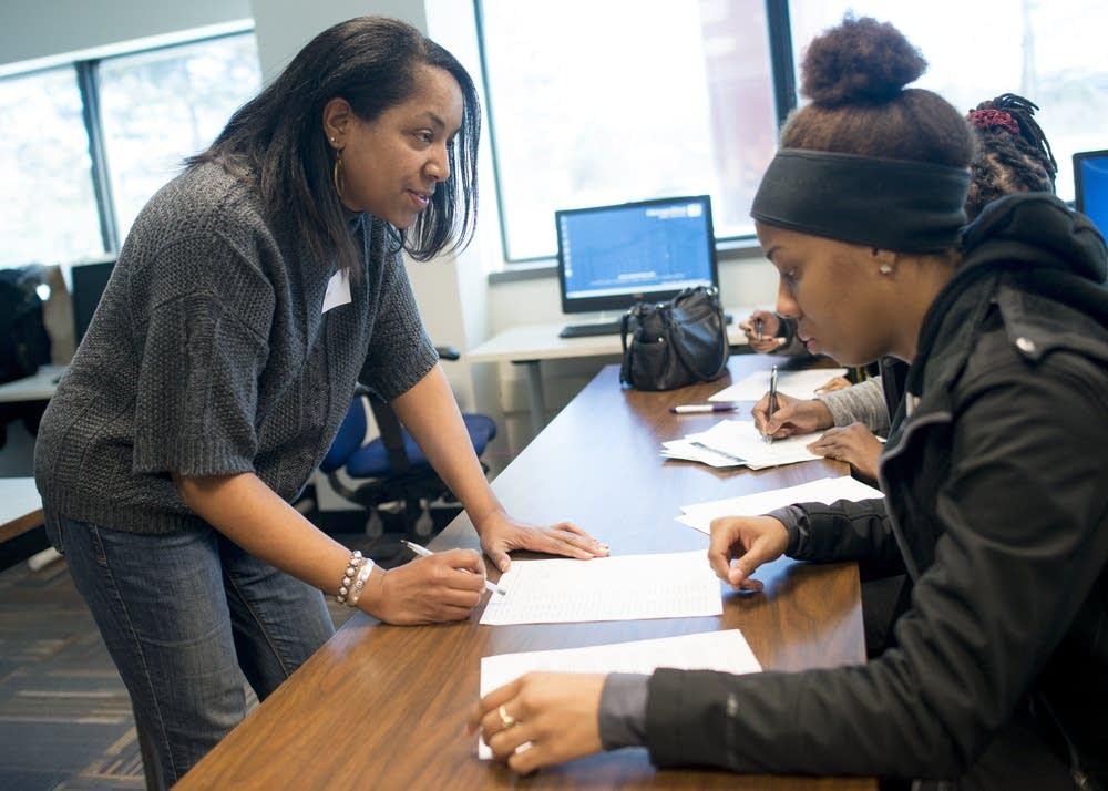 Volunteer instructor Karen Martin helps a student.