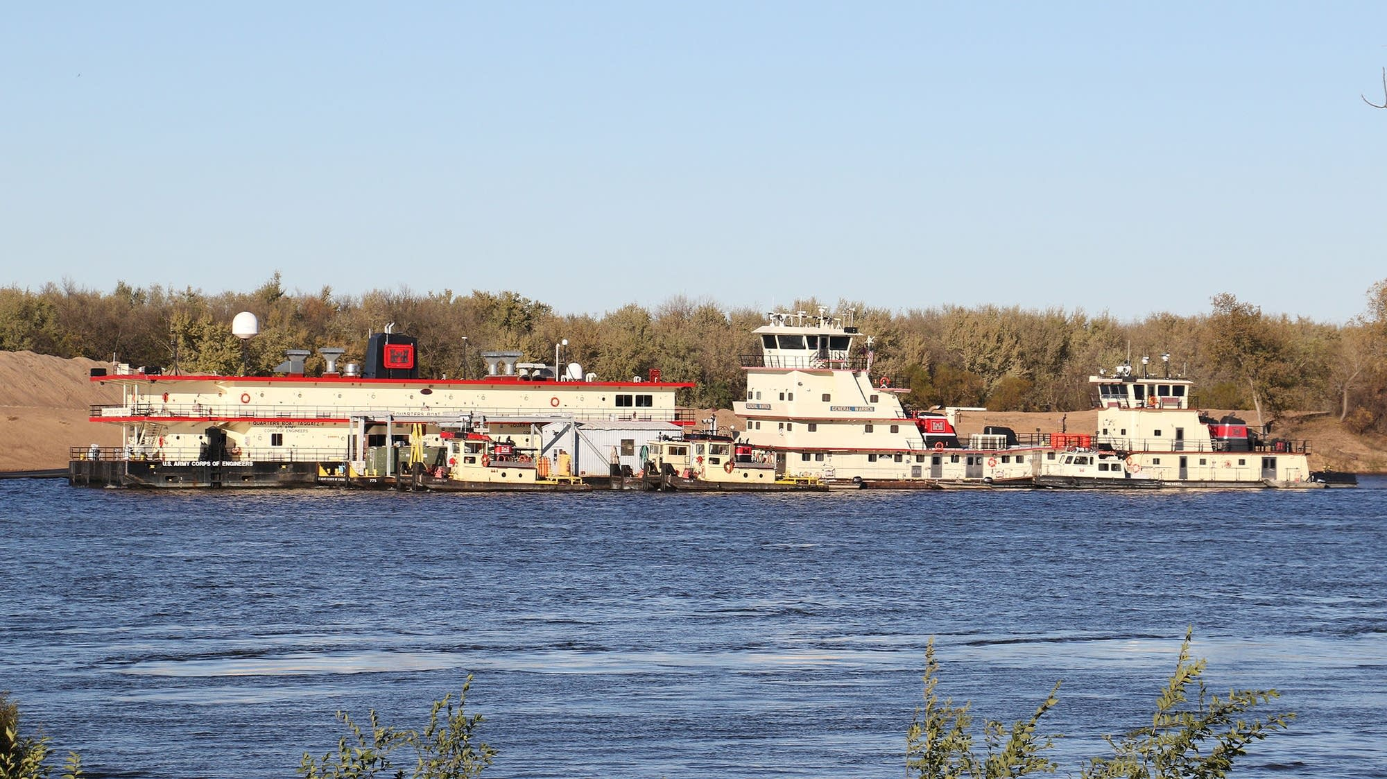 U.S. Army Corps of Engineers vessels are seen along the Mississippi River