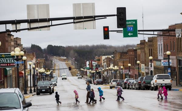 Children cross the street in downtown Chisholm.