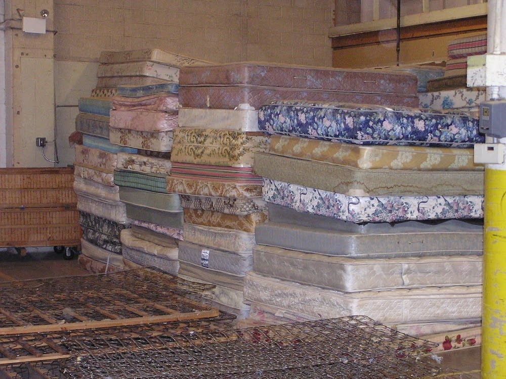 Mattresses wait to be recycled