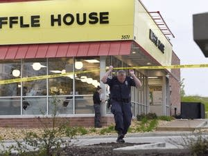 Officials work the scene of a shooting at a Waffle House in Nashville
