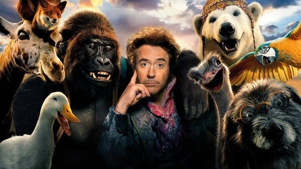 Robert Downey Jr's face surrounded by jungle animals (movie publicity shot)