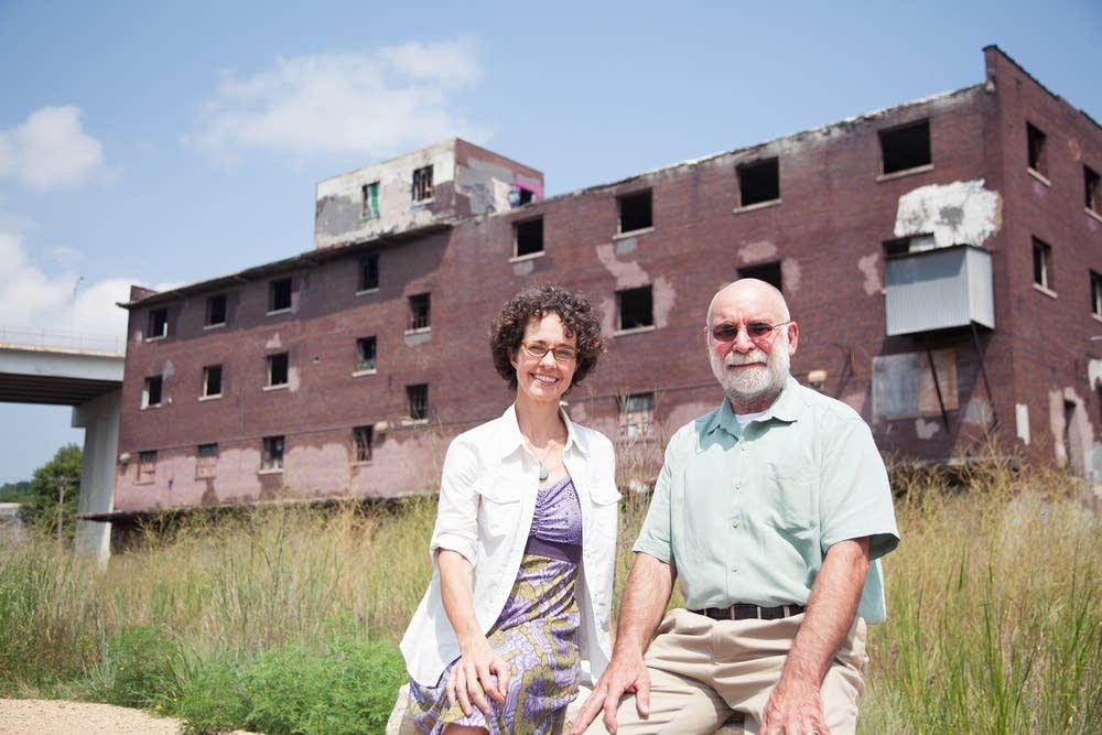 Tracy Sides and Dan McGuiness in front of depot