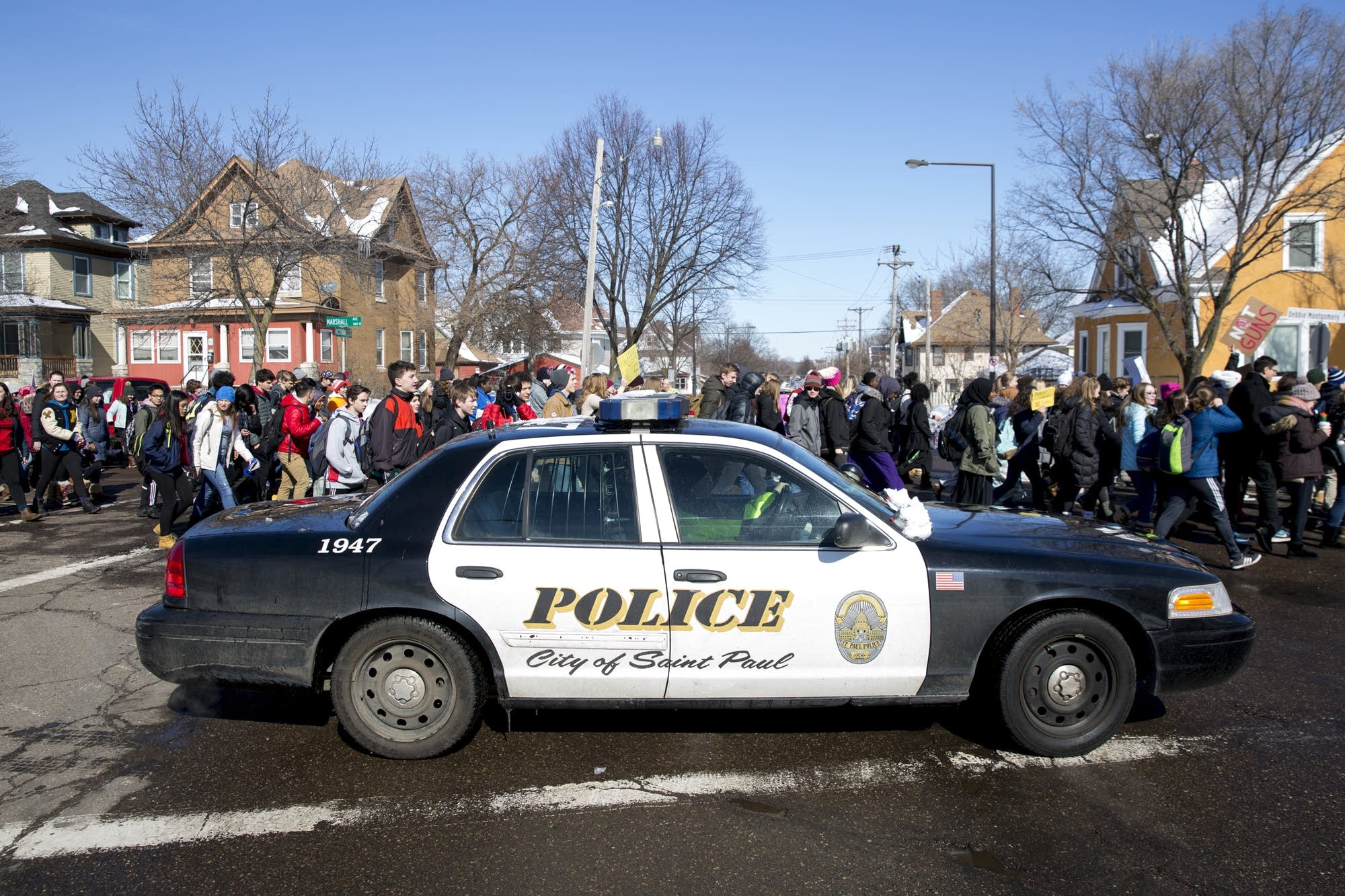 St. Paul police officers line the route of a march