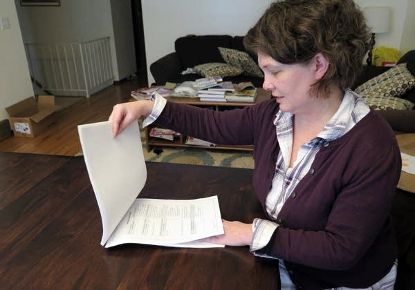 Kirstin Rogers looks through the application.