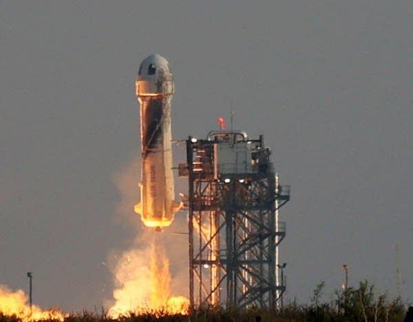 A rocket ship blasts into the sky.