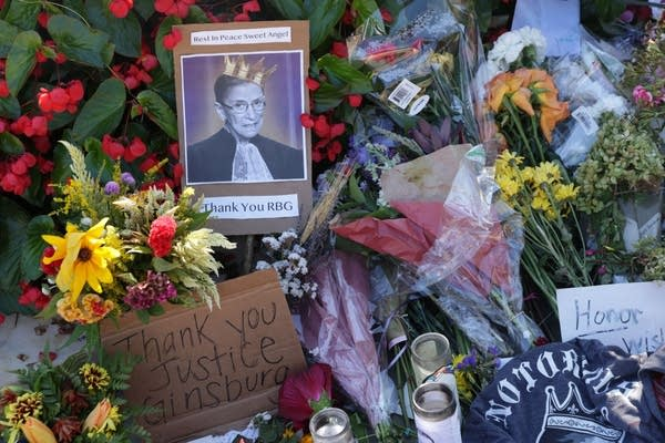 Signs and flowers at a makeshift memorial for the late Justice Ginsburg.