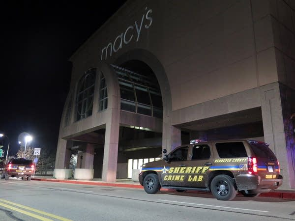 Hennepin County crime lab vehicles parked outside the MOA Macy's