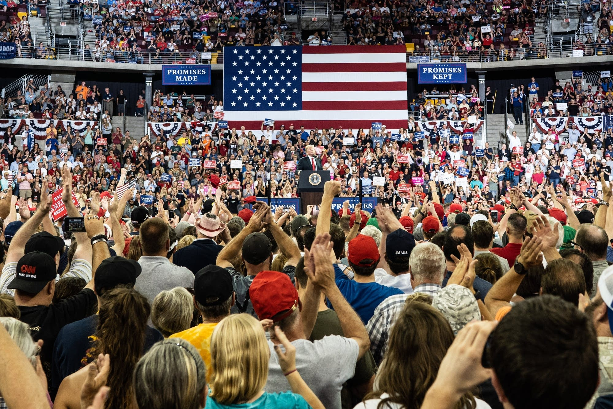 The crowd inside of Amsoil Arena cheers on President Donald Trump.