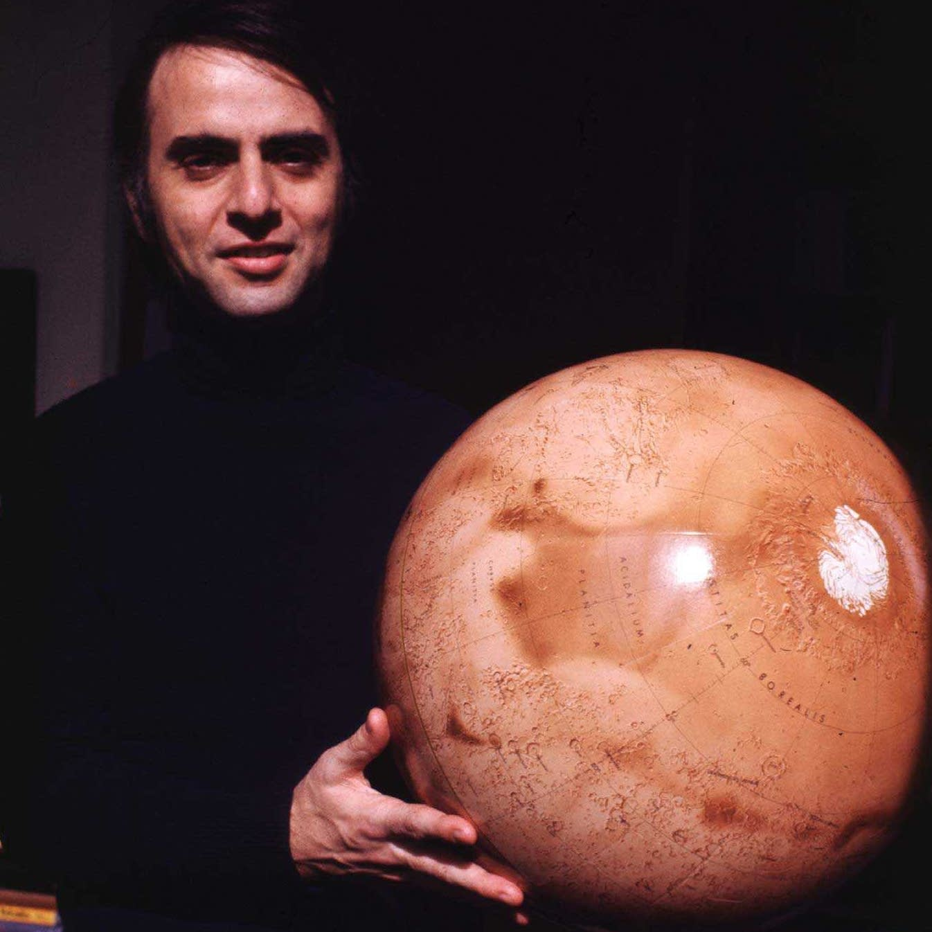 Carl Sagan holding Mars globe