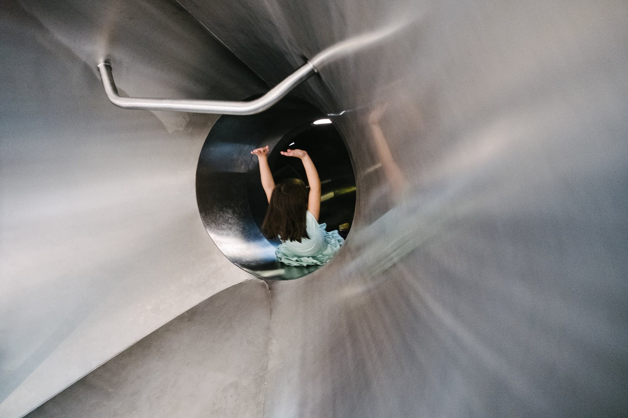 5-year-old Ava Tjelmeland rides the slide.