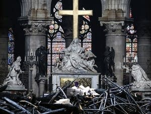 The altar surrounded by charred debris inside Notre Dame in Paris.