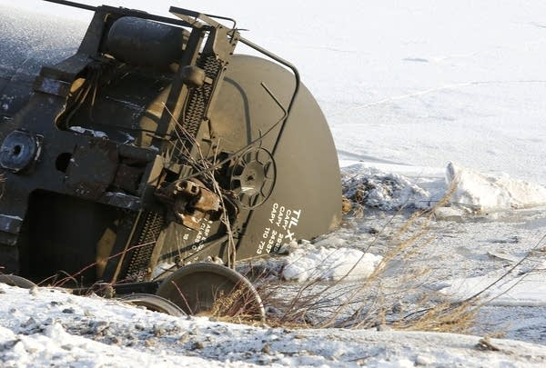 A rail car lays in the ice of the Mississippi.