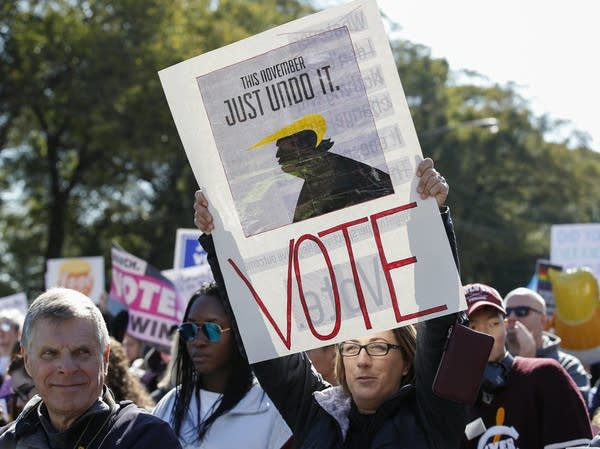 Women gather for a rally and march encouraging voter turnout.