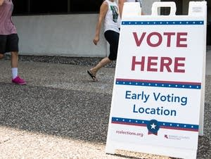Voters exit the Ramsey County Elections Plato Building.